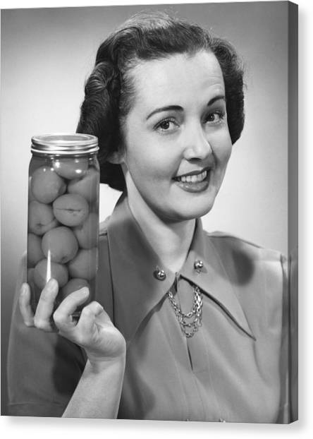 Woman Holding Jar Of Fruit Canvas Print by George Marks