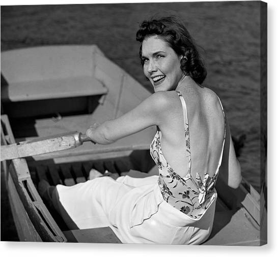 Woman In Row Boat Canvas Print by George Marks