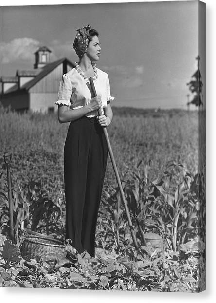 Woman In Vegetable Garden Canvas Print by George Marks