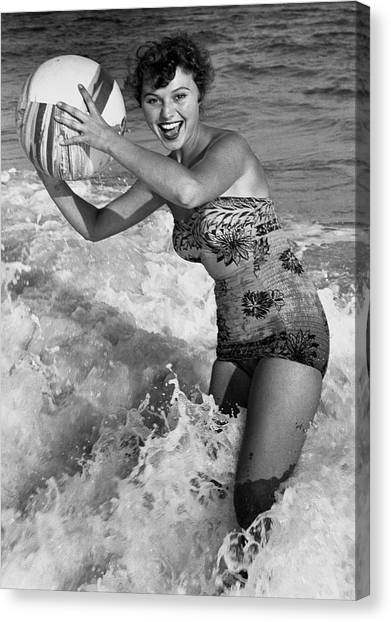Woman In Water W/beachball Canvas Print by George Marks