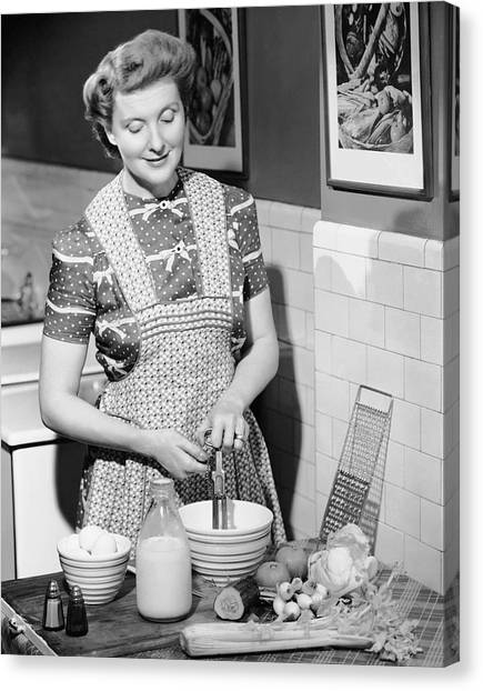 Woman Mixing Ingredients In Bowl Canvas Print by George Marks