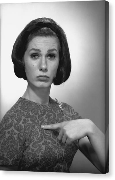 Woman Pointing On Herself In Studio, (b&w), Portrait Canvas Print by George Marks