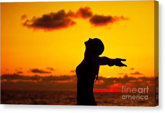 Woman Silhouette Over Sunset Canvas Print by Anna Om
