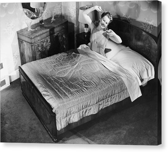 Woman Sitting In Bed Stretching Canvas Print by George Marks