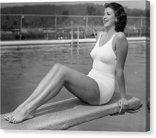 Woman Sitting On Divingboard Canvas Print by George Marks