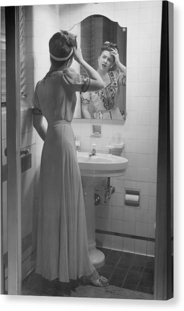 Woman Suffering Headache Standing In Front Of Bathroom Mirror, (b&w) Canvas Print by George Marks