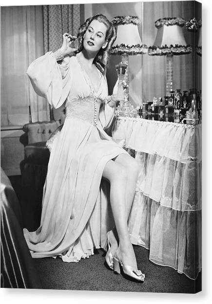 Woman W/ Bottle Of Perfume Canvas Print by George Marks