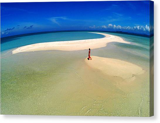 Woman Walking Along Sand Bar At A Tropical Beach In Malaysian Borneo's Sipadan-kapali-mabul Region Canvas Print by Tim Rock