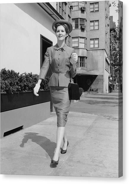Woman Walking Down Sidewalk Canvas Print by George Marks