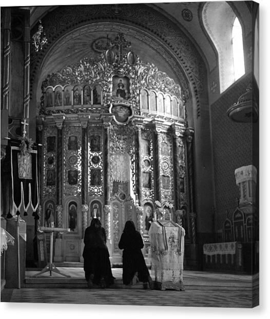 Women Praying In Church Canvas Print