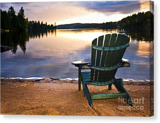 Adirondack Chair Canvas Print - Wooden Chair At Sunset On Beach by Elena Elisseeva