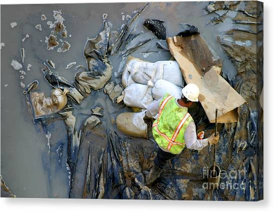 Working The Mud Canvas Print