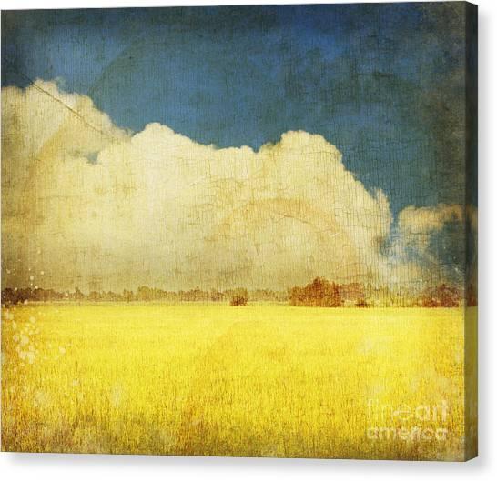 Clouds Canvas Print - Yellow Field by Setsiri Silapasuwanchai