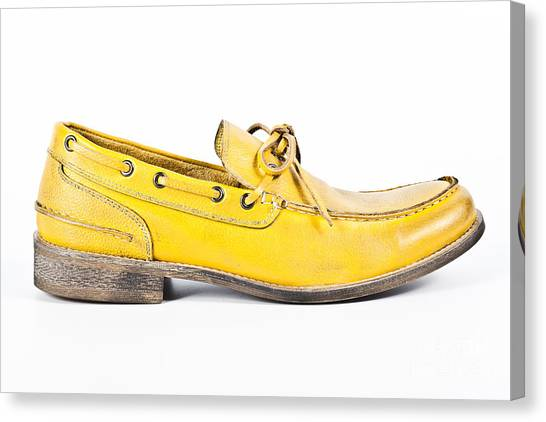 yellow Mens shoe Canvas Print by Chavalit Kamolthamanon