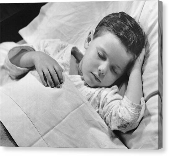 Young Boy Asleep In Bed Canvas Print by George Marks