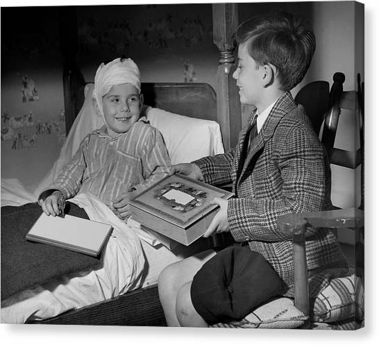 Young Boy Visiting Sick Friend Canvas Print by George Marks