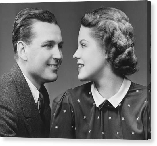 Young Couple Looking In Eyes In Studio, (b&w), Portrait Canvas Print by George Marks