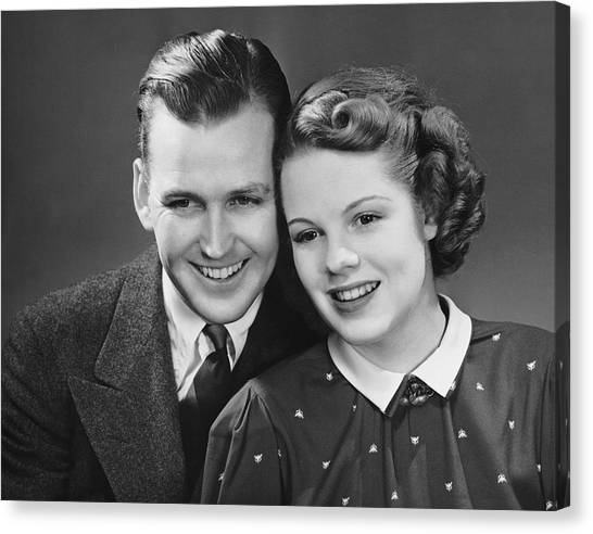 Young Couple Posing Together Canvas Print by George Marks