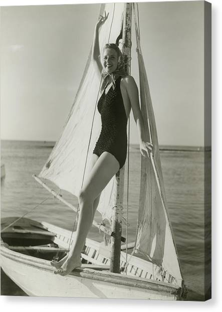 Young Woman Posing On Sailboat Canvas Print by George Marks