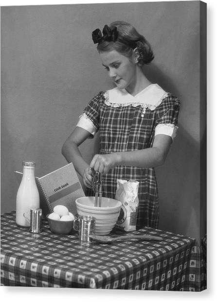 Young Woman Preparing Food Canvas Print by George Marks