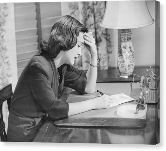 Young Woman Writing Letter At Desk, (b&w) Canvas Print by George Marks
