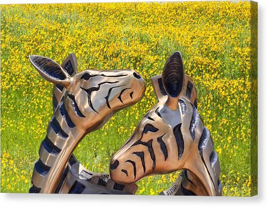 Zebra Sculptured Heads In Wildflowers Canvas Print by Linda Phelps