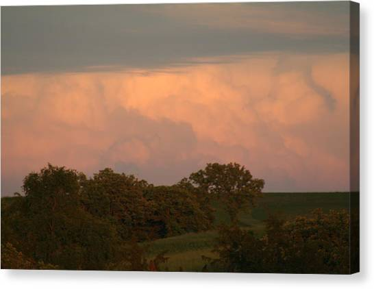 Clouds Of A Distant Storm Canvas Print by Linda Ostby