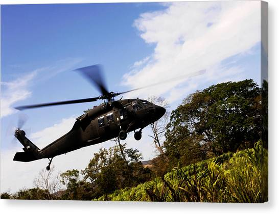 Medivac Canvas Print - A U.s. Army Uh-60 Black Hawk Helicopter by Stocktrek Images