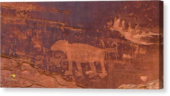 Ancient Native American Petroglyphs On A Canyon Wall Near Moab. Canvas Print
