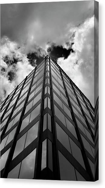 Clouds And Office Building Midtown Canvas Print by Robert Ullmann