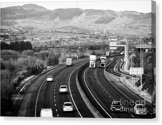 Brexit Canvas Print - cross border traffic on the N1/M1 motorway crossing the irish border between Northern Ireland and Re by Joe Fox