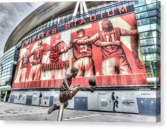 Arsenal Fc Canvas Print - Dennis Bergkamp Statue Emirates Stadium by David Pyatt