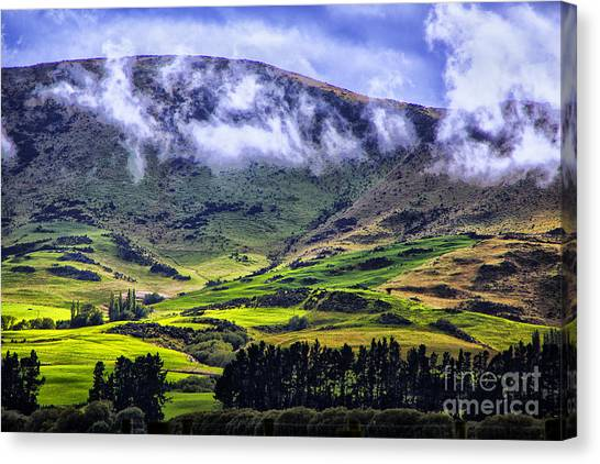 Down In The Valley Canvas Print by Rick Bragan