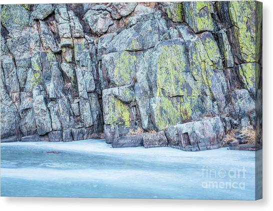 Frozen River And Rocky Cliff Canvas Print