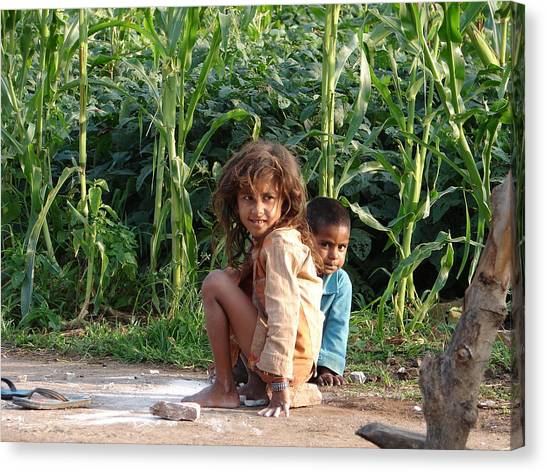 Girls In Her Own Field With Her Younger Brother Canvas Print by Sandeep Khanwalkar