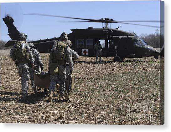 Green Berets Canvas Print - Green Berets Move A Simulated Casualty by Stocktrek Images