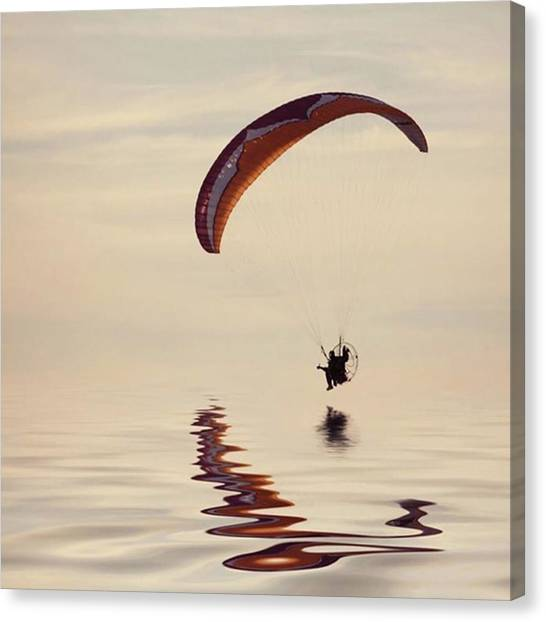 Beach Canvas Print - Powered Paraglider by John Edwards