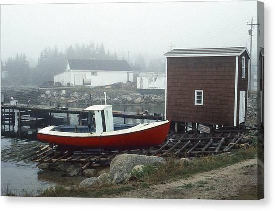 Red Fishing Boat In Fog Nova Scotia Canvas Print by Richard Singleton