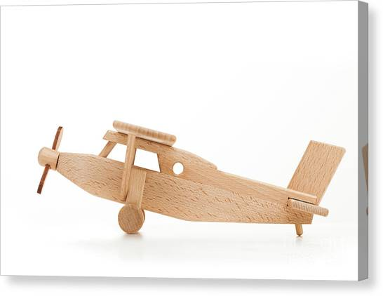 Toy Airplanes Canvas Print - Retro Wooden Airplane Isolated On White Background by Michal Bednarek