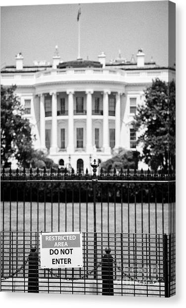 Whitehouse Canvas Print - security fence and restricted area signs at the south facade of the white house Washington DC USA by Joe Fox