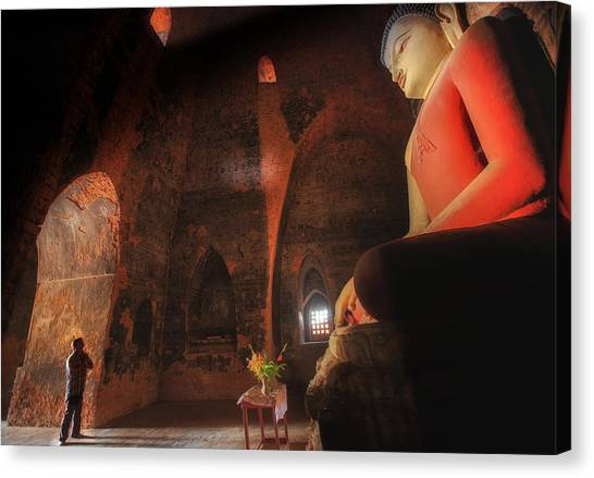 Candle Stand Canvas Print - Southeast Asian Man Praying  by Anek Suwannaphoom
