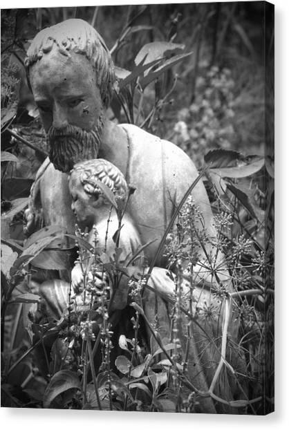 Statue In Flowers Canvas Print by Megan Verzoni