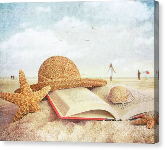 Straw Hat Book And Seashells In The Sand Canvas Print