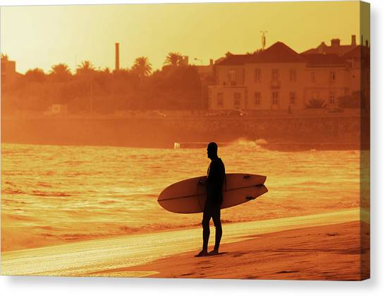 Surfboard Canvas Print - Surfer Silhouette by Carlos Caetano