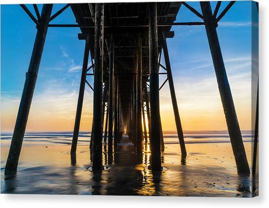 Ocean Sunsets Canvas Print - Under The Oceanside Pier by Larry Marshall
