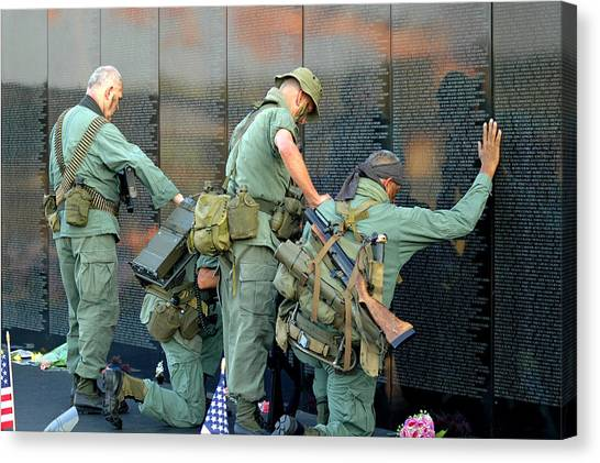 Veterans At Vietnam Wall Canvas Print