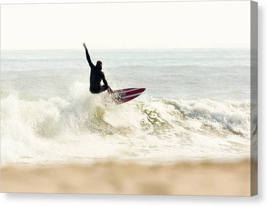 Winter Surfer On Sunny Day Canvas Print by Erin Cadigan