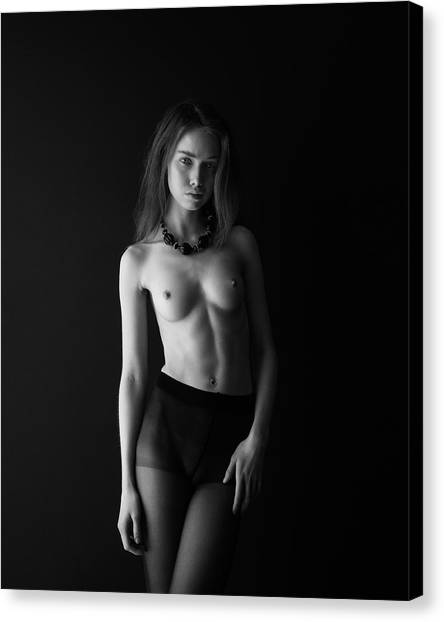 Young Woman In Front Of Black Wall Canvas Print