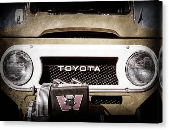 Toyota Canvas Print - 1978 Toyota Land Cruiser Fj40 Grille Emblem -0558ac by Jill Reger