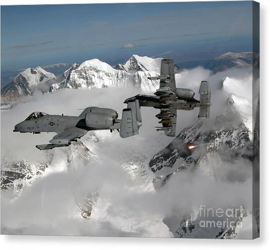 Canvas Print featuring the photograph A-10 Thunderbolt IIs Fly by Stocktrek Images